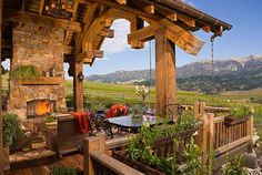 A porch with an amazing view.  Love the large log beams