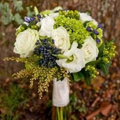 Navy and Green Wedding Bouquet:  blue viburnum berries, cream roses & gladiolus, green hydrangea, green hypericum berries, &  filler