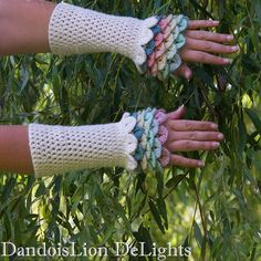 Newest pair of Dragon Scale Fingerless Gloves.  The sleeves have sparkles! $20 plus shipping. I can make them in any color scheme.  Message me to order your own!  #dragonscale #dragon #crochet #crochetersofinstagram #crocodile #GoT #gameofthrones #cosplay #costume #wedding #handmade #dressup #fairy #fairytale #DandoisLionDeLights www.facebook.com/DandoisLionDeLights