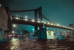Hurrican_Sandy causes flooding in New York City Streets are flooded under the Manhattan Bridge in the Dumbo section of Brooklyn, N.Y., Monday, Oct. 29, 2012.- Sci/Tech news