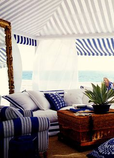 Gorgeous outdoor gazebo in nautical colors blue and white with brown accents! #coastalliving