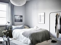 Ikea clothing rack. Grays, Blacks, and Whites for a calm, masculine bedroom via @MyDomaine