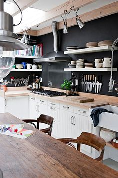 Cozy home. I like the shelves instead of cabinets, huge sink, the table, the floor, the walls... Pretty much the whole thin.