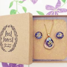 """A lovely customer created this Lost Forest set from the eco resin treasures in store! The Irish Pansy Pebble necklace in purple paired with the Blue…"" Lost Forest Jewellery: www.lost-forest.com"