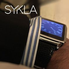 "SYKLA M1 (Model One) - The Elegant Smart Watch (Gray Metal with Black Leather). A beautifully crafted elegant smart watch with sleek metal housing and soft leather straps. Compatible with both Android and iPhone for making and receiving calls. Voice control compatible with Google Now and Apple Siri. Get notifications such as missed calls, voice mail, e-mails, SMS messages, and more right on your wrist (Android only). ""Always On"" technology uses a special translucent TFT screen which can..."