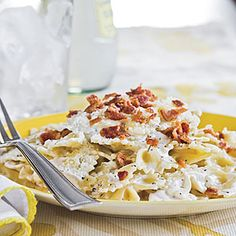Bacon Bow-Tie Pasta...  8-oz. pkg Bow Tie Pasta, 1/2 lb Bacon, 8-oz. pkg soft Cream Cheese, 1/4 c soft Butter, 1 1/2 tsp. Italian Season, 2/3 c. Milk, 1/2 c. grated Parmesan Cheese... Cook pasta; Drain; Keep warm. Cook bacon; Blot; Crumble. Beat next 3 with electric mixer on LOW til smooth. Gradually add milk, beat til smooth. Microwave cream cheese mix at HIGH for 3 min til heated thru, whisk every 30 seconds. Pour over warm pasta, tossing to coat. Top with bacon and Parmesan.