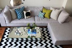 Eclectic cushions upholstery and black and white striped rug - Beautiful Apartment in Manhattan, New York