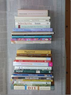 so doing this! so simple! all I need is L brackets :) i can have two different piles: christine warren's books and j.r. ward's books!