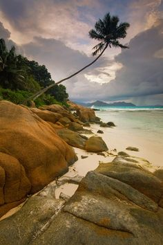 Anse Severe, Seychelles ::   A stormy sunset over Anse Severe beach, La Digue Island, Seychelles. Photo by Michael Anderson