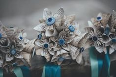 Handmade bouquet made from book pages and buttons. Flowers are origami. I could not bring myself to cut up a book so I photocopied the pages and aged them!  We specifically chose books that we loved.