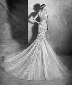 VILEN style: Sexy Chantilly lace mermaid wedding dress with lace appliqués and gemstone embroidery with nude details. Bodice with sheer overlay in illusion tulle embellished with lace and guipure appliqués on the front and back.