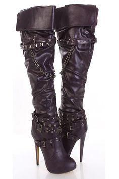 Rock out with stylish boot. Featuirng faux leather, fold-over cuff, buckle straps decor with studded embellishment, drape chain link, slightly slouchy detailing, close pointed toes, side zipper closure.  Hidden Platform. Insole with faux leather lining, lightly cushion foot-bed, out-sole with rubber traction. Approx 5 inch heels 1/2 inch platform.