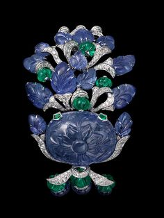 Cartier  Bracelet Platinum, one 75.37-carat carved sapphire, melon-cut sapphire and emerald beads, sapphire carved leaves, brilliants.