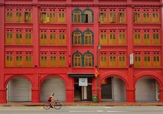 Cyclist in Singapore  #shotonSamsungS7 #photoguide #Singapore #arches #patterns #red #colours #phonetography #smartphone #photography