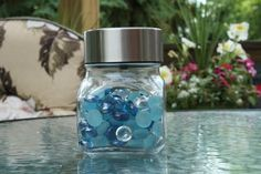 DIY Solar Jar Light. Perfect for a little light on the patio. I'll be sure to get this stuff at a dollar store!