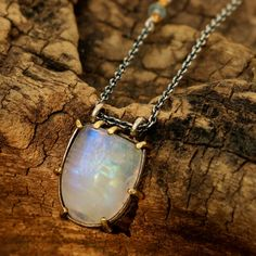 D shaped moonstone pendant necklace with silver and brass setting on oxidized silver chain
