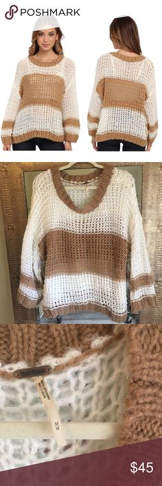 Free People Monaco Pullover Sweater Size Medium Free People Monaco Cream and Tan Striped Oversized Pullover Sweater Size Medium Loose fitting. Measures approximately 28 inches from shoulder to hem. 40% cotton, 30% nylon, 20% wool, 10% alpaca. Hand wash cold, dry flat.  Great condition. 💐Bundle & save 20%. Free People Sweaters