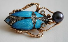 "Gold scarab brooch Russia 1910's, guilloche enamel, diamonds in silver sets, topazes, mikomoto pearl. Marked ""ГАСЛ""."