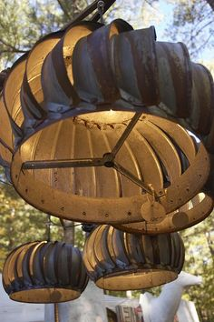 ~ Recycled Vent Fan ~ Fun lighting for a porch or under a tree....