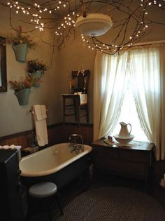 There are so many quirky pieces in this bathroom that I like, but I think my favourite is the fairy lights in the branches.