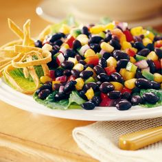 This colorful Black Bean salad is dressed with a light, lime vinaigrette and only takes a few minutes to prepare. Serve with tortilla chips or as a side dish.