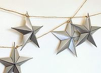 paper star garland, crafts, seasonal holiday decor, shabby chic, Creative use of wrapping paper shiny stars to drape your windows for the holidays See more here