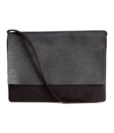 Black. Small, envelope-shaped shoulder bag with flap with magnetic closure. Lined. Size 7 x 8 3/4 in.