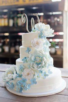 Spring wedding cake. Blue flowers.