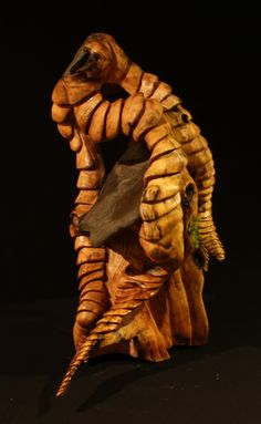 Will Worsnopp-wood carving. : Beneath the Surface: Sycamore root w/ stone August, 2010