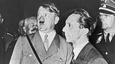 Hitler and his propaganda chief Joseph Goebbels during the Nazi election campaign in 1933. Hess in background