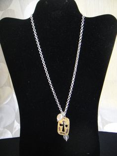 """Cross cutout """"Love Never Fails"""" necklace.  Silver chain.  10"""" in length"""