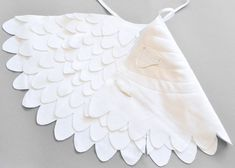 White wing cape for kids. Children can use it as a fairy wing set but it could also be part of a swan, seagull or egret Halloween or Carnival costume.