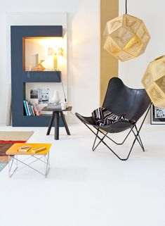 giant letter shelf. LTR Occasional Table by Charles & Ray Eames, 1950. Hardoy Chair (also known as Butterfly Chair) by Ferrari-Hardoy, Kurchan and Bonet, 1939.