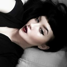 pretty girl goth dramatic makeup look fierce brows winged liner dark red lips