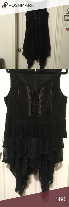 TORRID lace corset dress size 16/18 (worn once) TORRID brand (I believe it's a size 2) black lace dress. The straps are wide enough to hide your bra straps. The entire dress is black and it has a criss cross ribbon like corset in front.  The hem two layers of lace and it's fully lined. This dress is very well made and sturdy. Even though it's made of lace it will not be easily snagged and has a little weight to it. This dress was worn one time. Again Torrid size 2 although the tag has…