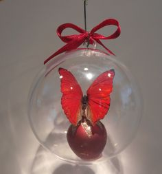 """""""Cymothoe sangrias"""" from Nigeria     The Blood Red Cymothoe     80mm clear ornament   $20.00 US Butterfly Ornaments, Clear Ornaments, Sangria, Christmas Bulbs, Blood, Holiday Decor, Red, Crafts, Manualidades"""