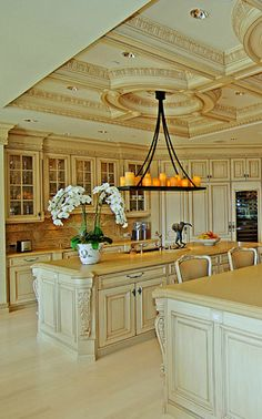 Kitchen - state-of-the-art appliances, Italian hand-carved wood cabinetry, and abundant quartz countertops