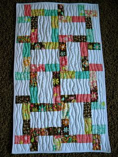 charm pack quilt with wavy line motif