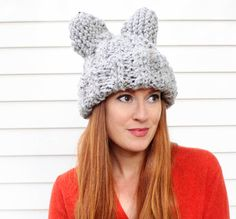 Gina Michele: Cat Ear Hat. Free knit pattern. We can't get enough cats! Knit this big eared cat hat with just 1 skein of Lion Brand Wool-Ease Thick & Quick and size 13 knitting needles. Perfect for Halloween, or any time you need to add a little whimsy to your look!