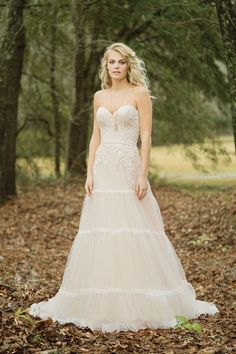 Lillian West lillian west style 6451 The lace appliques, trimmed tiers, and soft skirt make this gown unique. A sweetheart neckline, natural waistline, and chapel length train complete the look. Boho Wedding Dress, Chic Wedding, Boho Dress, Bridal Dresses, Wedding Styles, Wedding Gowns, Elegant Wedding, Wedding Stuff, Dream Wedding
