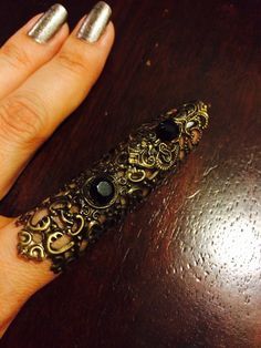 A personal favorite from my Etsy shop https://www.etsy.com/listing/233379846/lace-shield-full-finger-ring-made-in