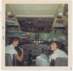 1968 November Susanne Malm & colleague pose in the cockpit of a Pan Am Boeing 727 in between flights.
