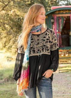 "Sundance ARIA TOP -- A top with intricate, geometric embroidery over flowing silk has an air of unbounded elegance. Camisole included. Dry clean. Imported. Exclusive. Sizes S (4 to 6), M (8 to 10), L (12 to 14), XL (16). Approx. 29""L."
