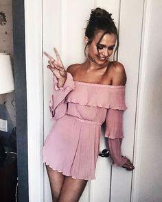 Pretty pink off the shoulder dress.