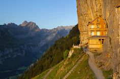 The extraordinary Berggasthaus Aescher-Wildkirchli was built into the side of a 100-metre-high vertical cliff face during the 19th century, photo: Appenzellerland Tourismus / swiss-image.ch / Roland Gerth