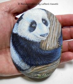 Hand painted stone with black and white giant panda bear on a forest tree !  This is a natural stone which is painted by me, transformed into a pretty portrait of a panda on a tree! A great painted stone for you and a clever Gift Idea for your beloved friends!  Is painted on a smooth sea stone which i have collected from a beach on a Greek island. Is painted with fine art quality acrylic colors and very small brushes for the detail , is signed on the back and covert with strong acrylic stone…