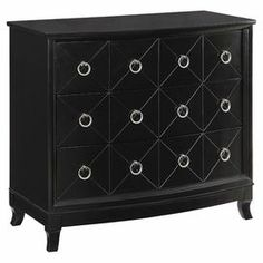 """Wood chest in black with nickel-finished ring pulls and curved legs.   Product: ChestConstruction Material: Wood and metalColor: Black and nickelFeatures: Three drawersDimensions: 33"""" H x 36"""" W x 18"""" D"""