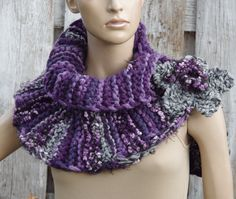 Knited Scarf - Capelet. Unique scarf made . Warm and pleasant to the touch. Beautiful unique design. Color: shadows purple, grey, black, pink Size: One size fits all irregural shape approx 103/30cm 40,55/11,81 materials used: 10%wool, 70%acrylic, 20% shenille button Care instruction: hand wash using warm water. Because of different monitors and screen resolutions, colors may look different on the screen than really.
