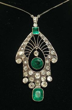 Art Deco Emerald Diamond Platinum Drop Pendant Necklace. Important  pendant drop necklace with beautiful handmade open workmanship, designed with a spiderweb motif.One emerald cut emerald on top weighing approximateley 1 carat with beautiful intense green color and high qualty middle center emerald round cut weighing approx. 2 carats.The third bottom emerald is cushion cut beautiful color and clean quality with very little inclusions, weighing approx. 1.50 carats. c 1920s