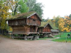 Old Norwegian Village. Built in the 1300s, and lifted onto those posts in the 1700s. Originally from Hovin in Norway.